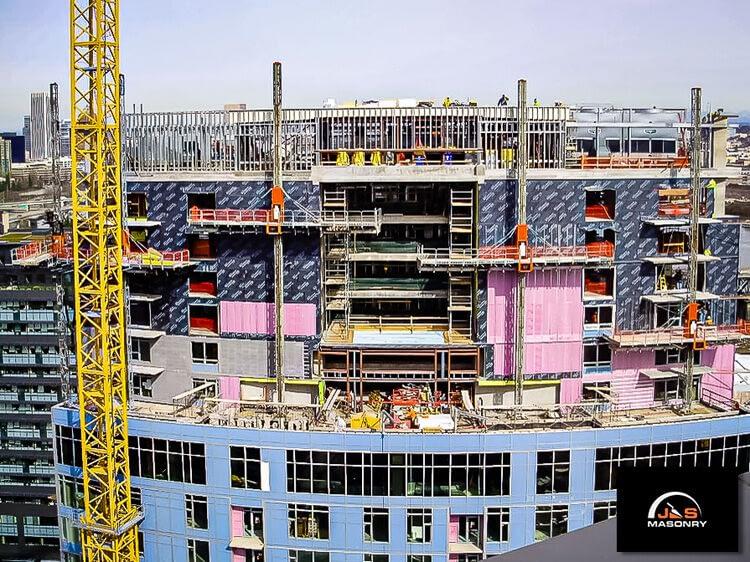 J&S Masonry's construction site at Mirabella with hydraulic mast climbing scaffold